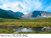 Mountain peaks and tundra at summer season. The Khibiny Massif are the highest mountains of the Kola Peninsula, northern Russia. Стоковое фото, фотограф Кекяляйнен Андрей / Фотобанк Лори