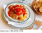 cusine catalan salad with potato and fish in white plate for dinner. Стоковое фото, фотограф Яков Филимонов / Фотобанк Лори