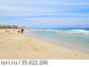 People on the sandy beach of Los Arenales del Sol, Spain. Стоковое фото, фотограф Alexander Tihonovs / Фотобанк Лори