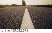 Road in the golden autumn day during sunset. Стоковое видео, видеограф Dzmitry Astapkovich / Фотобанк Лори