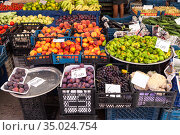 Alanya, Turkey-circa Oct, 2020: A lot of different fruits and vegetables are on the counter at the farmer market in city. Seasonal assortment is on sale in large bazaar. Редакционное фото, фотограф Кекяляйнен Андрей / Фотобанк Лори