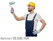 male worker or builder with paint roller. Стоковое фото, фотограф Syda Productions / Фотобанк Лори
