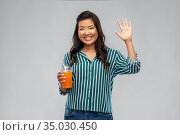 asian woman with juice in plastic cup with straw. Стоковое фото, фотограф Syda Productions / Фотобанк Лори