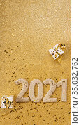 Happy new year concept. Card with handcrafted lettering 2021 and gold gift. Space for text. Стоковое фото, фотограф Сергей Молодиков / Фотобанк Лори