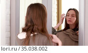 Woman tests clothes by wardrobe mirror. Стоковое видео, видеограф Ekaterina Demidova / Фотобанк Лори