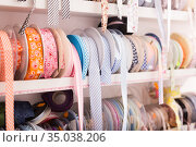 Colored ribbons on needlework store shelves. Стоковое фото, фотограф Яков Филимонов / Фотобанк Лори