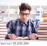 Nerd funny student preparing for university exams. Стоковое фото, фотограф Elnur / Фотобанк Лори