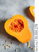 Fresh butternut squash on the grey background. Butternut Pumpkin. Halves of raw orange pumpkin. Contrast photo. Healthy Meal Prep, recipe preparation photos. Seasonal pumpkin. Стоковое фото, фотограф Nataliia Zhekova / Фотобанк Лори