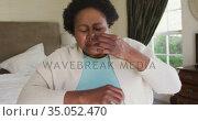 African american senior woman sneezing on her elbow. Стоковое видео, агентство Wavebreak Media / Фотобанк Лори