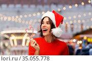 happy young woman in santa hat on christmas. Стоковое фото, фотограф Syda Productions / Фотобанк Лори
