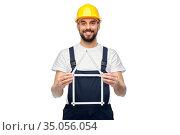 happy male worker or builder with carpenter's rule. Стоковое фото, фотограф Syda Productions / Фотобанк Лори