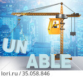Unable turning into able concept with crane and words. Стоковое фото, фотограф Elnur / Фотобанк Лори