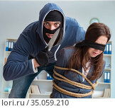 Criminal taking businesswoman as hostage in office. Стоковое фото, фотограф Elnur / Фотобанк Лори