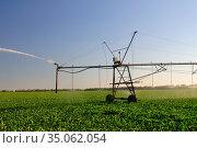 Automatic irrigation system in the field. Стоковое фото, фотограф Арестов Андрей Павлович / Фотобанк Лори