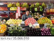 male vendor in the department with vegetables and fruits. Стоковое фото, фотограф Яков Филимонов / Фотобанк Лори