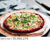 beetroot pizza crust with fresh mangold leaves. Стоковое фото, фотограф Ольга Сергеева / Фотобанк Лори