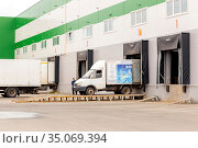 Russia Samara March 2020: A large van stands unloading outside a warehouse on a summer day. Russian text: integrita, high quality food products for restaurants and bars, moscow, saint petersburg. Редакционное фото, фотограф Акиньшин Владимир / Фотобанк Лори