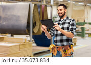 happy builder with tablet computer and tools. Стоковое фото, фотограф Syda Productions / Фотобанк Лори