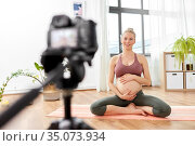 pregnant woman or yoga blogger with camera at home. Стоковое фото, фотограф Syda Productions / Фотобанк Лори