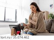 sick woman with medicine has video consultation. Стоковое фото, фотограф Syda Productions / Фотобанк Лори