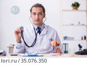 Young male doctor cardiologist working in the clinic. Стоковое фото, фотограф Elnur / Фотобанк Лори