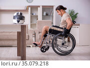 Young male motor-cyclist suffering at home after accident. Стоковое фото, фотограф Elnur / Фотобанк Лори