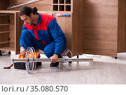 Young handsome male carpenter working indoors. Стоковое фото, фотограф Elnur / Фотобанк Лори