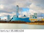 Kazakhstan Central Concert Hall on bank of Ishim River. Nur Sultan. Редакционное фото, фотограф Валерия Попова / Фотобанк Лори