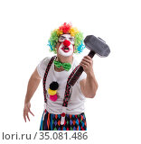 Funny clown with a hammer isolated on white background. Стоковое фото, фотограф Elnur / Фотобанк Лори