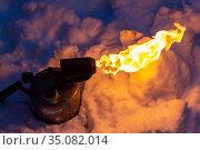 Old torch with a flame. Стоковое фото, фотограф Евгений Ткачёв / Фотобанк Лори