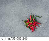 heap of peppers on gray slate. Стоковое фото, фотограф Ольга Сергеева / Фотобанк Лори