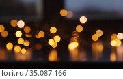 blurred christmas lights on window sill. Стоковое видео, видеограф Syda Productions / Фотобанк Лори