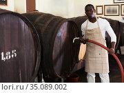male winegrower working in wine-vault. Стоковое фото, фотограф Яков Филимонов / Фотобанк Лори