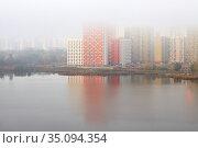 New colored residential buildings in fog. Стоковое фото, фотограф Азат Хайрутдинов / Фотобанк Лори