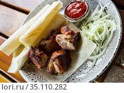 Oriental grilled pork meat shashlik. Стоковое фото, фотограф Яков Филимонов / Фотобанк Лори