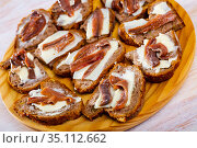 Bread with butter and salted anchovy fillets. Стоковое фото, фотограф Яков Филимонов / Фотобанк Лори