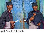 Two monks at the Abuna Garima monastery Tigray. Abba Garima Monastery... (2020 год). Редакционное фото, фотограф Sergi Reboredo / age Fotostock / Фотобанк Лори