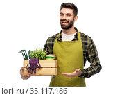 happy gardener or farmer with box of garden tools. Стоковое фото, фотограф Syda Productions / Фотобанк Лори