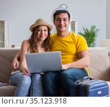 Young family preparing for travel vacation. Стоковое фото, фотограф Elnur / Фотобанк Лори