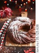 Sweet Bread Wreath. Chocolate brioche garland with coconut flakes. Holiday recipes. Braided Bread. Cinnamon Twist Bread Wreath. Christmas Wreath. Стоковое фото, фотограф Nataliia Zhekova / Фотобанк Лори