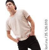 Handsome rap dancer in baseball cap and tshirt. Стоковое фото, фотограф Гурьянов Андрей / Фотобанк Лори