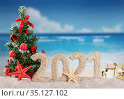 New year on the beach. Christmas tree, inscription 2021 on sunny seaside. Стоковое фото, фотограф Сергей Молодиков / Фотобанк Лори