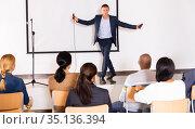 Young emotional male coach giving motivational speech. Стоковое фото, фотограф Яков Филимонов / Фотобанк Лори