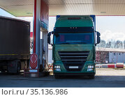 Two trucks at a gas station. Стоковое фото, фотограф Юрий Бизгаймер / Фотобанк Лори