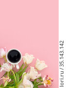 cup of coffee with pink tulip. Стоковое фото, фотограф Ekaterina Demidova / Фотобанк Лори