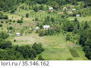 Farms are on slopes of mountains in the Durmidor massif. Northwestern Montenegro. (2016 год). Стоковое фото, фотограф Кекяляйнен Андрей / Фотобанк Лори