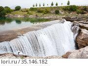 Plain waterfall of the Cijevna river. It is called Montenegrin Niagara Falls. Surroundings of Podgorica city. Montenegro, Europe. Стоковое фото, фотограф Кекяляйнен Андрей / Фотобанк Лори