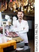 Male assistant using scales in butcher shop. Стоковое фото, фотограф Яков Филимонов / Фотобанк Лори