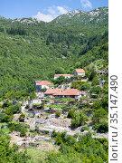 Rural landscape with mountains and farm houses in Zabljak municipality, Montenegro (2016 год). Стоковое фото, фотограф Кекяляйнен Андрей / Фотобанк Лори