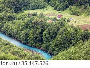 Farms are on slopes of mountains in the Durmidor massif close to the Tara river. Northwestern Montenegro. (2016 год). Стоковое фото, фотограф Кекяляйнен Андрей / Фотобанк Лори